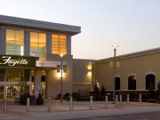 a sunset picture of the main entrance to fayette mall