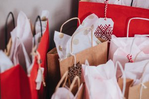 waste: brown and red bags filled with festive tissue paper