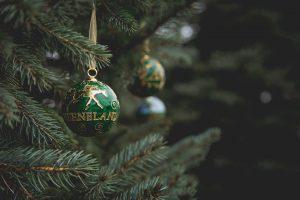 a green keeneland ornament on a christmas tree