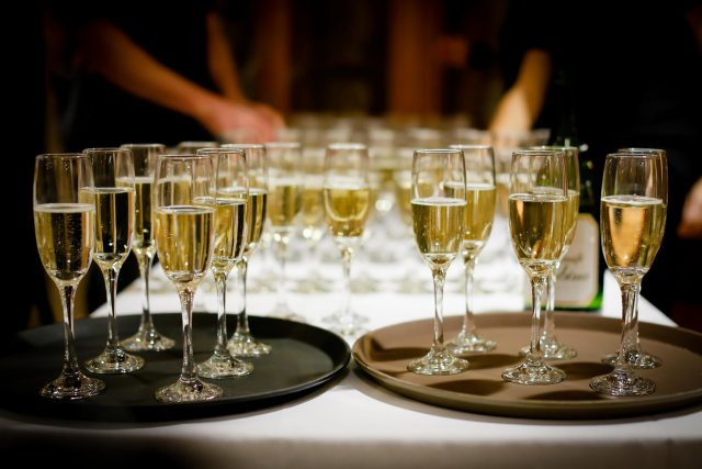 celebrate: champagne glasses on 2 trays on a white table cloth