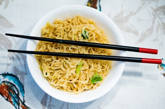 uk dining: a bowl with noodles and chop sticks on top