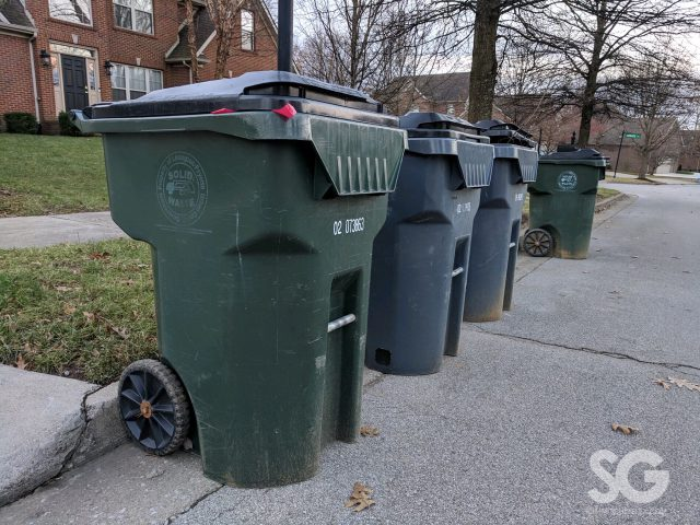 waste: a row of 3 herbies on the curb for presidents' day