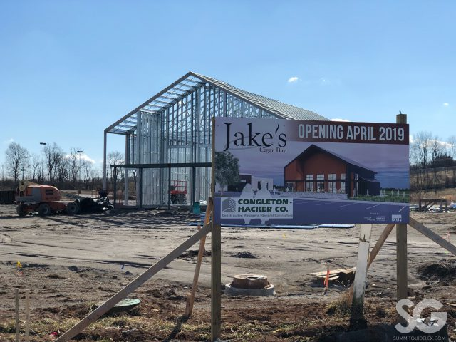 metal framing for a building and a sign for jake's cigar bar