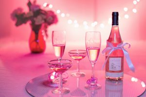 valentine's day: pink coloring with a bottle of champagne and champagne glasses