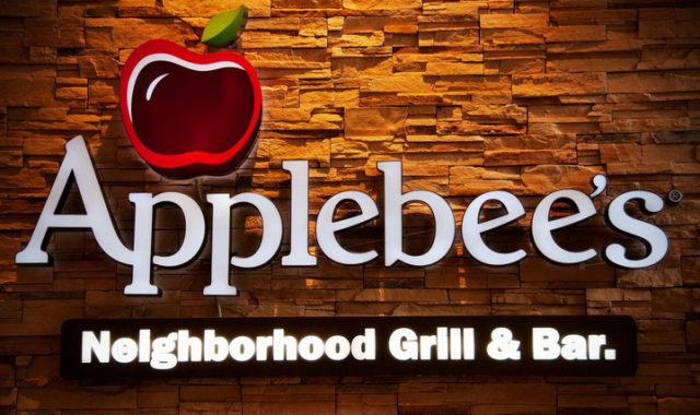 Applebee's neighborhood grill and bar sign with a textured background