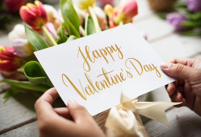 a card that says happy Valentine's Day with a bouquet of flowers