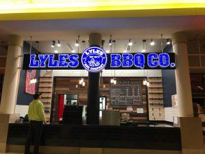 lexington restaurant: mall food court restaurant that says lyles bbq in blue