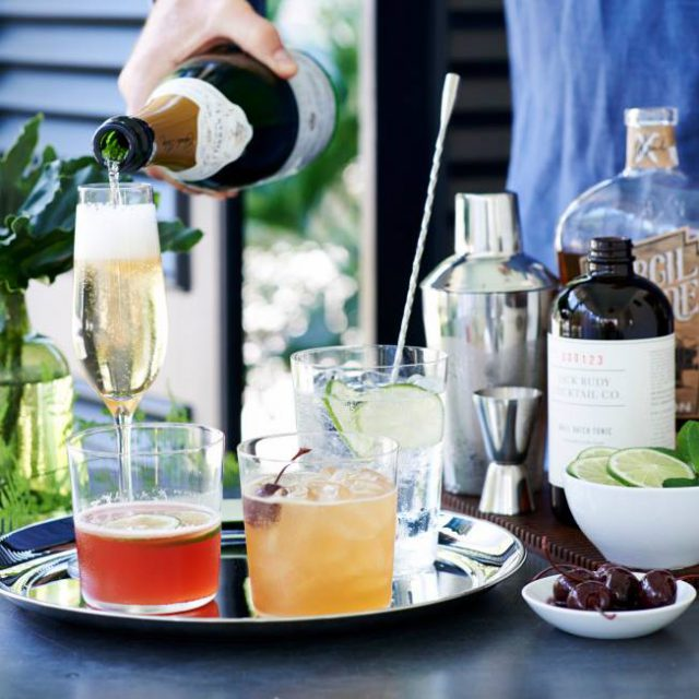 williams-sonoma: glasses and drinks on a metal tray