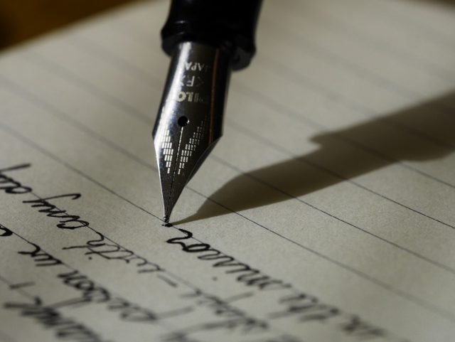 whisky: a fountain pen writing on paper