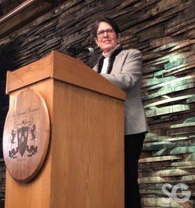 Women Leading Kentucky: woman in a blazer talking at a podium