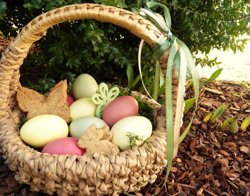Egg Hunts: painted eggs in a light wicker basket