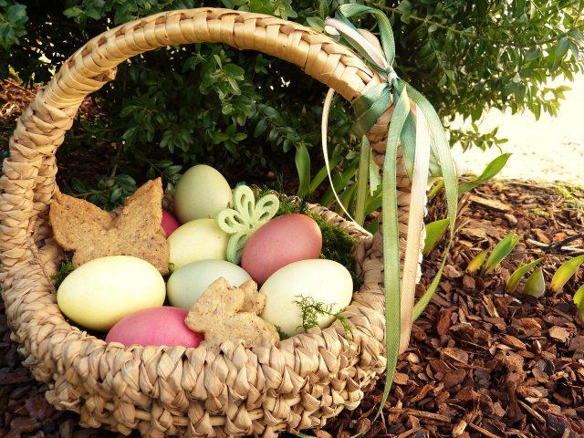 Egg Hunts: painted eggs in a light wicker basket