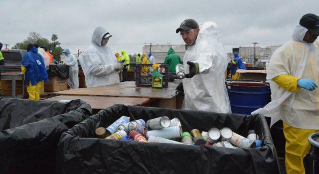 Hazardous Materials: people in white hazmat suits sorting materials
