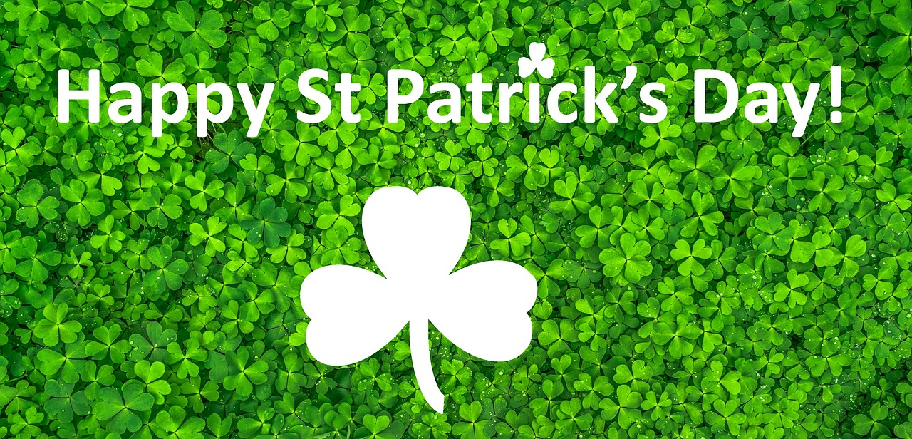 four-leaf clovers with Happy St. Patrick's Day in white