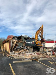 LaRosa's: construction on a yellow building with a red roof