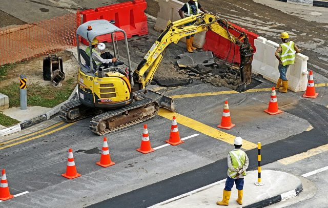 Work Zone: construction crew working on a road