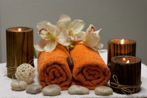 Lexington Green Mall: two burnt orange towels with flowers, pebbles, and candles