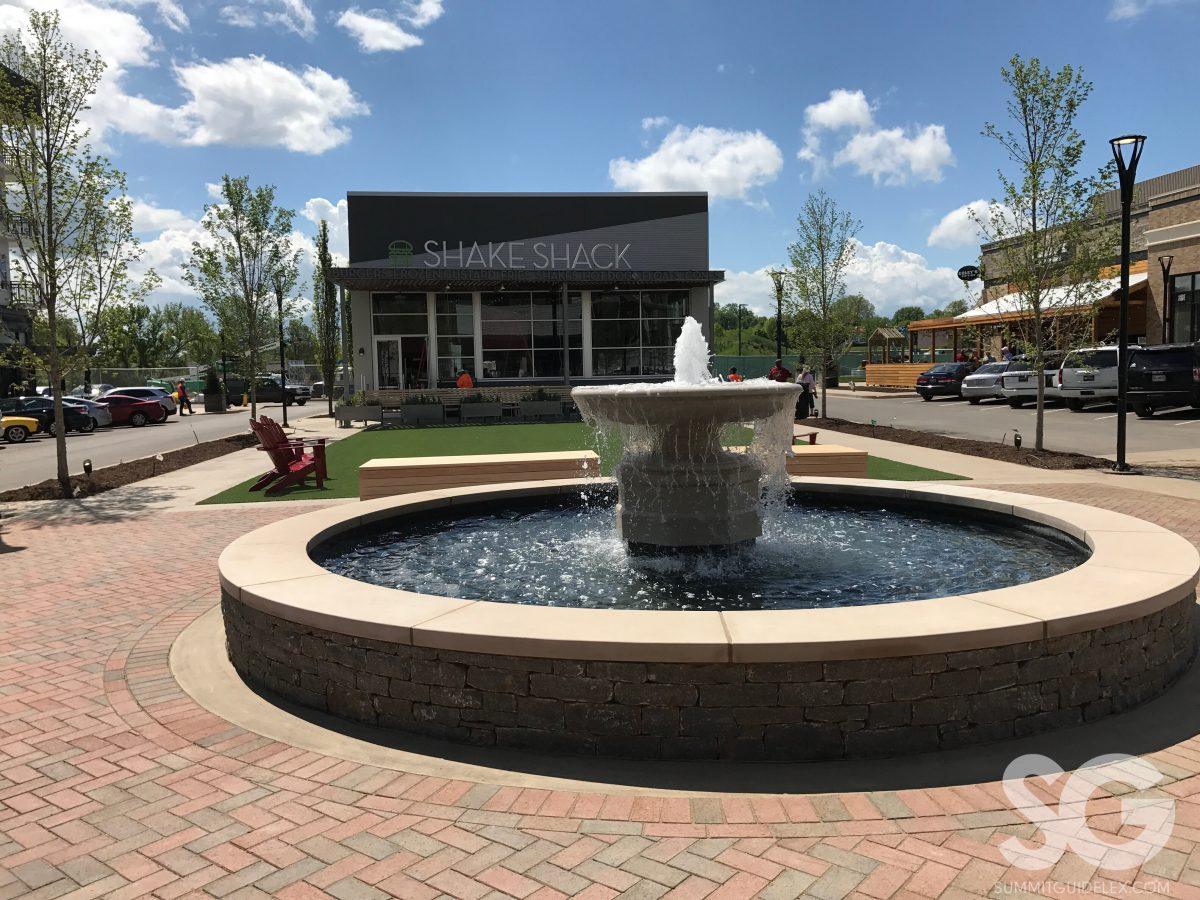 Sounds of Summer: fountain with a green space and shake shack behind