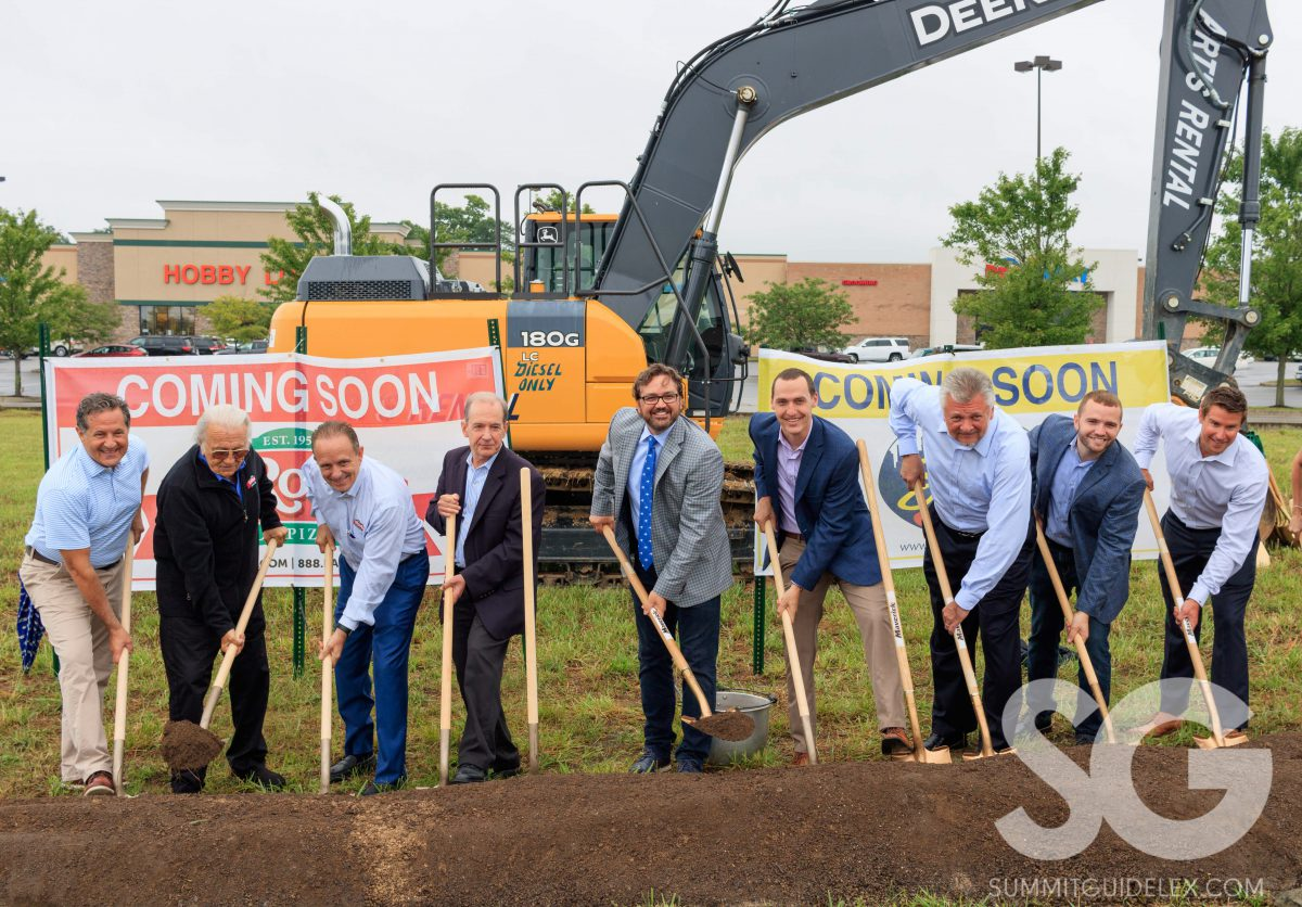 Skyline Chili: group of people holding shovels over a mound of dirt smiling at the camera