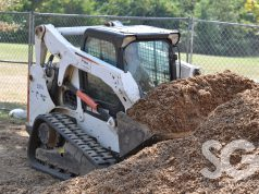 Shillito Park: bobcat shoveling mulch