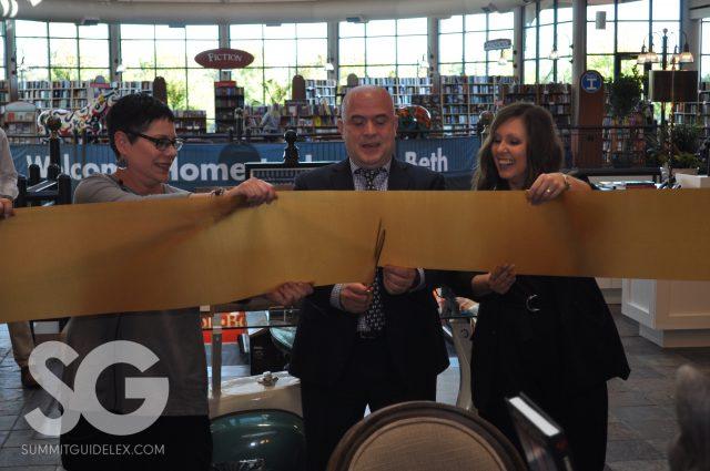 Joseph-Beth: three people cutting a thick brown ribbon