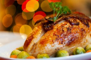 """Thanksgiving"""" turkey with sprouts around it on a white plate"""