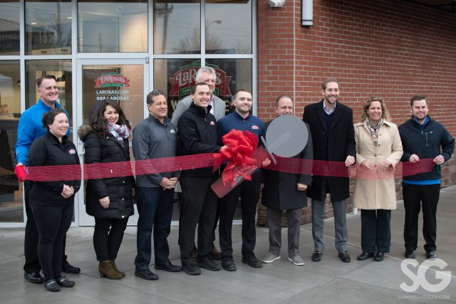 LaRosa's: group of people doing a ribbon cutting