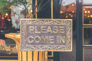 Summit Christmas: a metal sign that says please come in