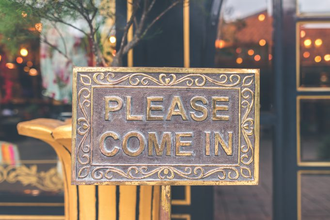 Christmas: a metal sign that says please come in